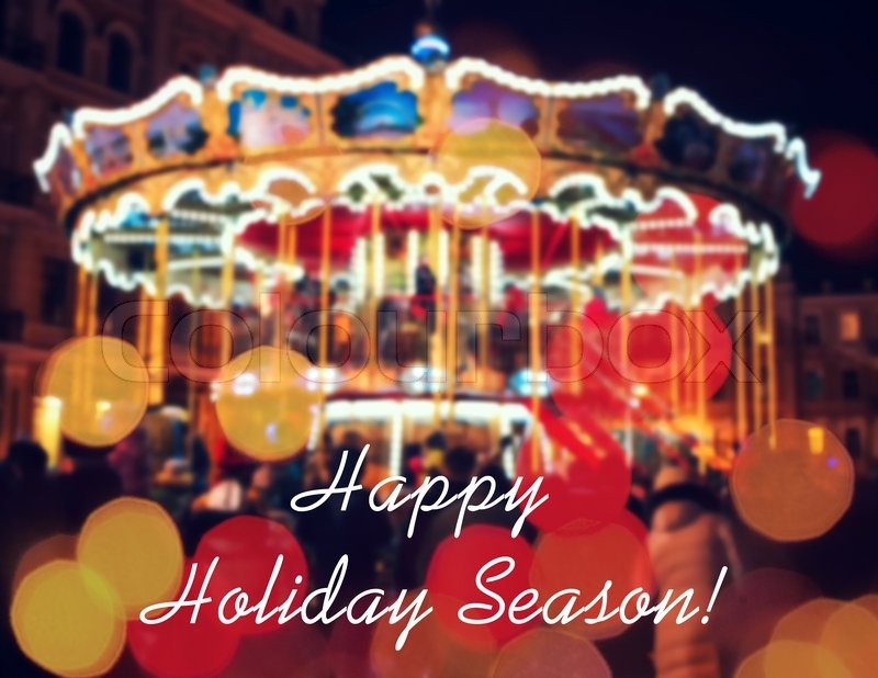 merry go round illuminated at night new year greeting on background with blurred carousel and bokeh merry christmas and happy new year card