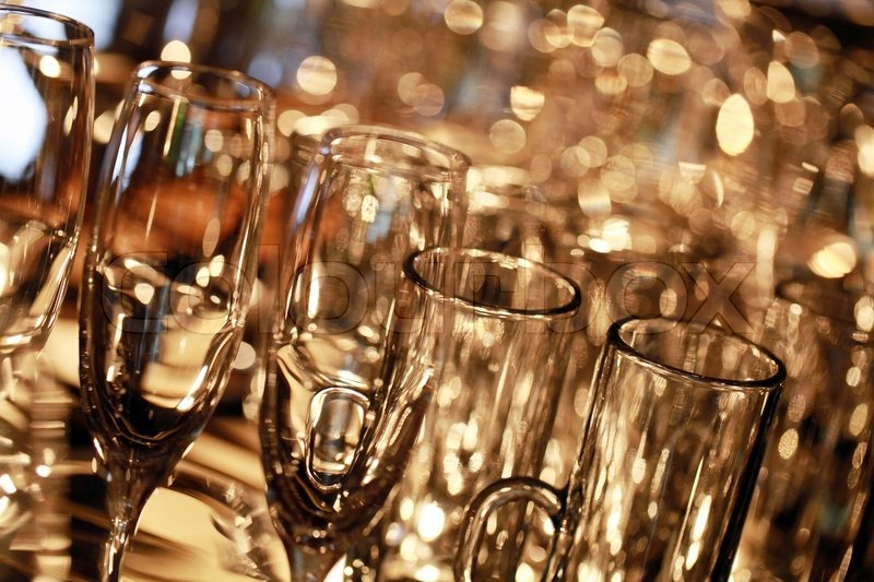Many empty glasses for a wine drying in the bar. Close up photo with selective focus, stock photo