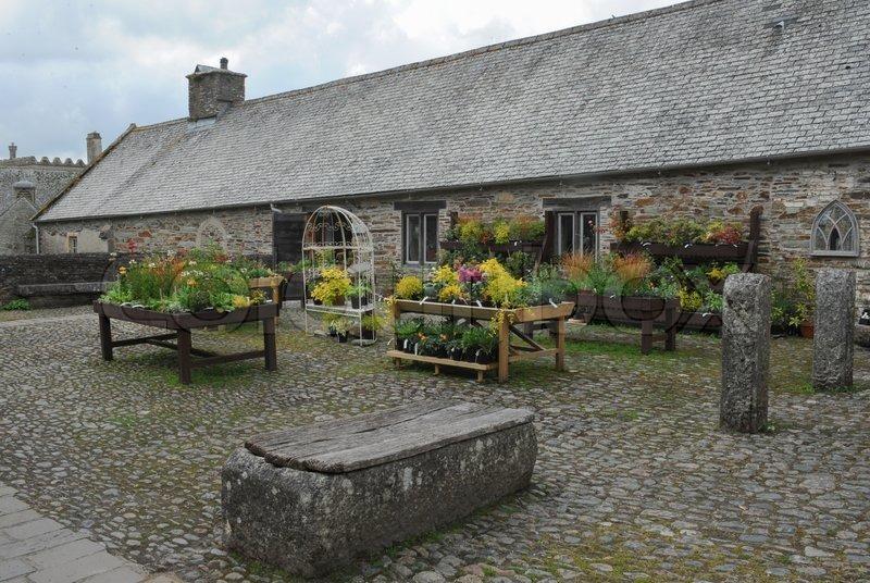 Cobble Stone Courtyard at Buckland Abbey Gardens and Estate , 700 Year old House, near Yelverton, Devon, England, UK, stock photo