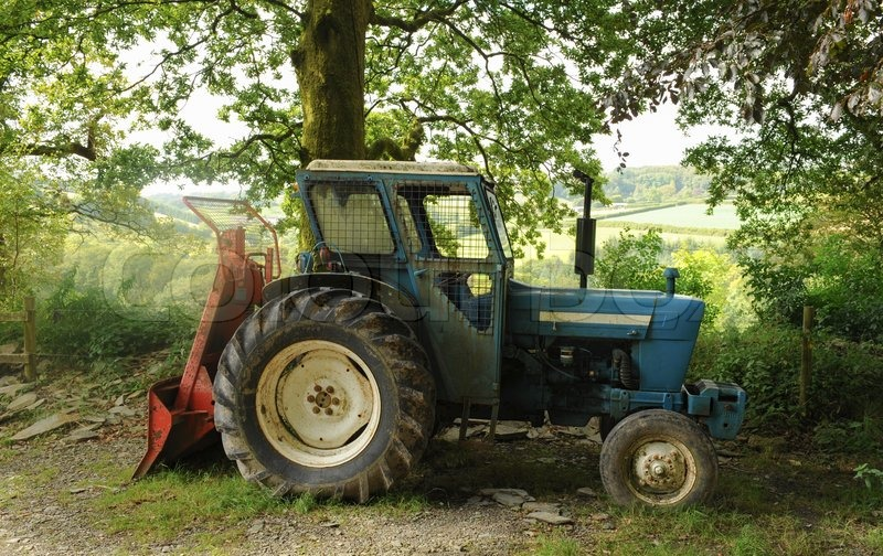 Blue Tractor in the Grounds of Arlington Court Estate and Gardens, near Barnstaple, Devon, England, UK, stock photo