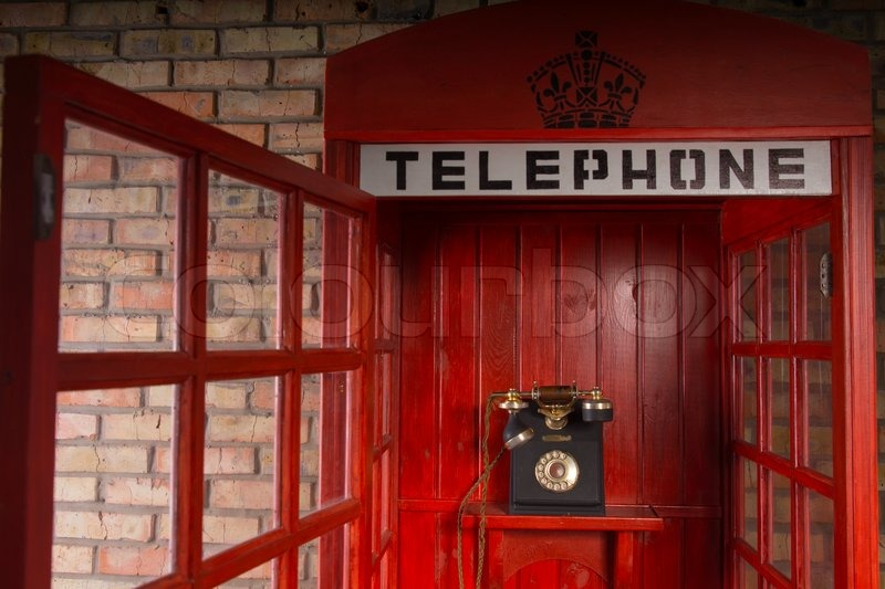 Close Up Detail Of Red Public Telephone Booth With Old