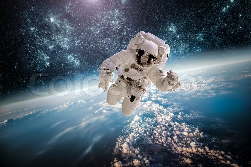 Astronaut in outer space against the backdrop of the planet earth. Elements of this image furnished by NASA, stock photo