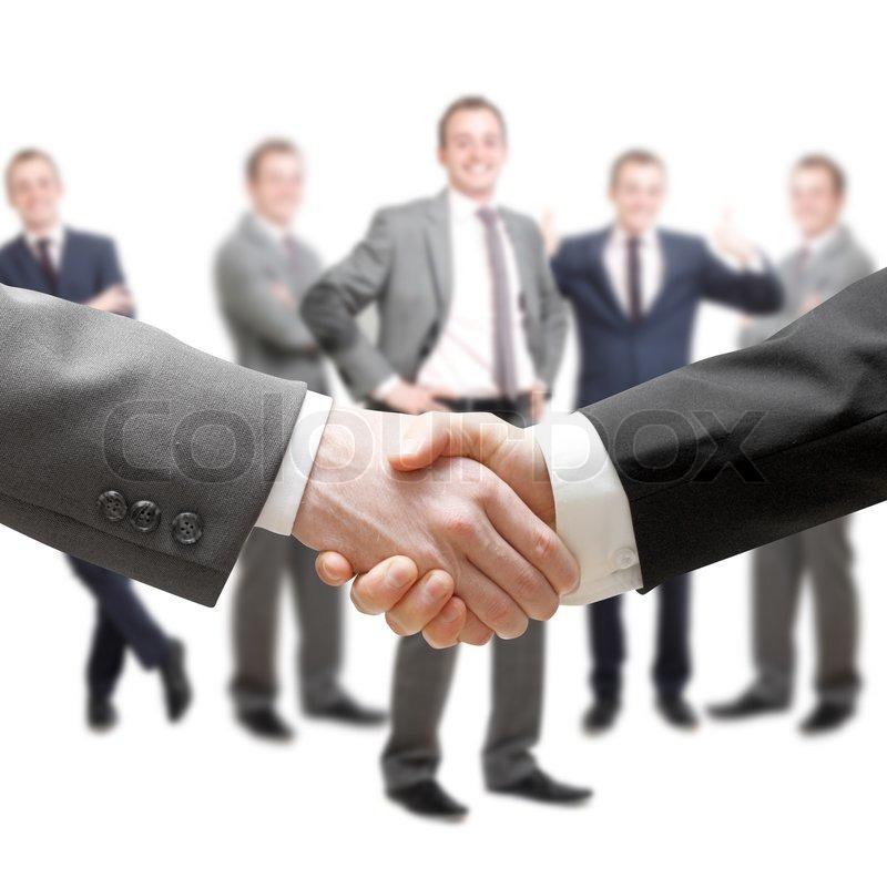 A Businessman Team Handshake At Office Building