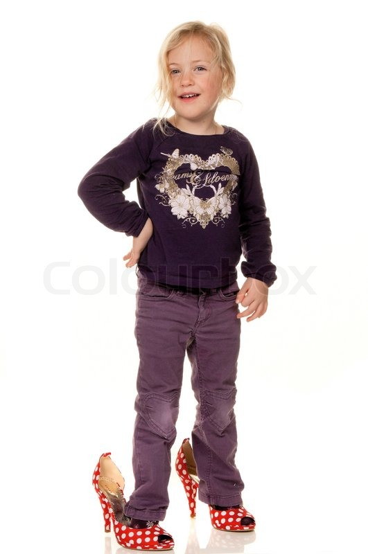 Children With Big Shoes Symbol For Growth And Future Stock Photo