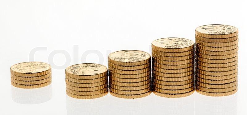Einige Berge Von Münzen Auf Weißem Hintergrund Stockfoto Colourbox