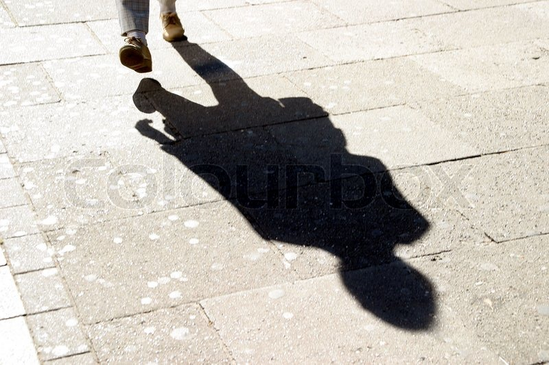 Shadow of an anonymous person | Stock Photo | Colourbox