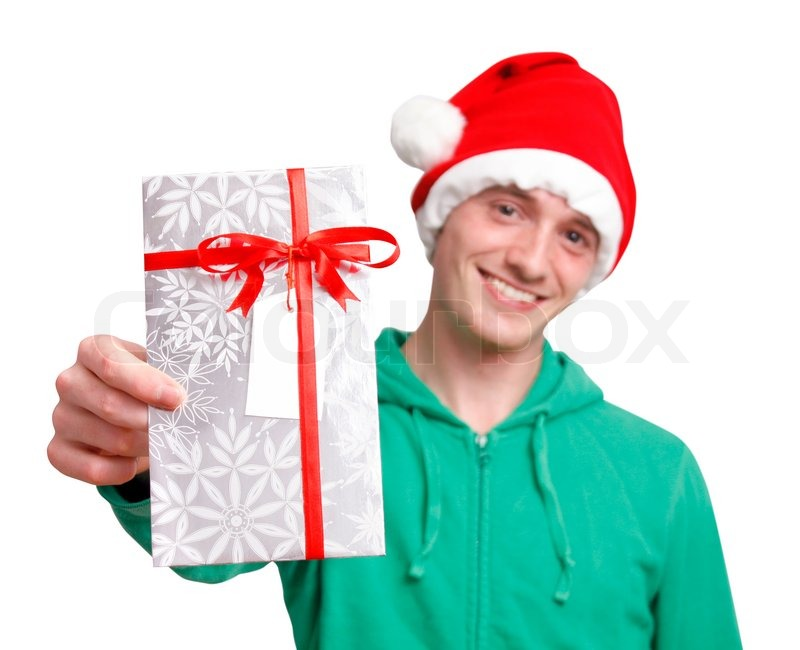 Man with santa hat holding christmas present | Stock Photo | Colourbox