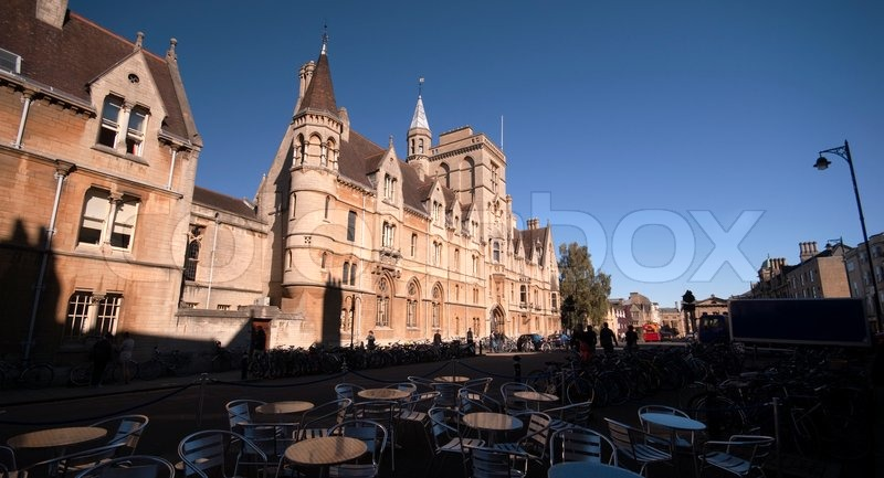 Oxford Town in Oxfordshire. Street view with street restaurant, buildings and traffic, stock photo
