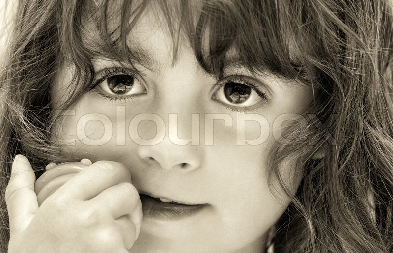 Beautiful brown eyes of a baby girl thinking, stock photo