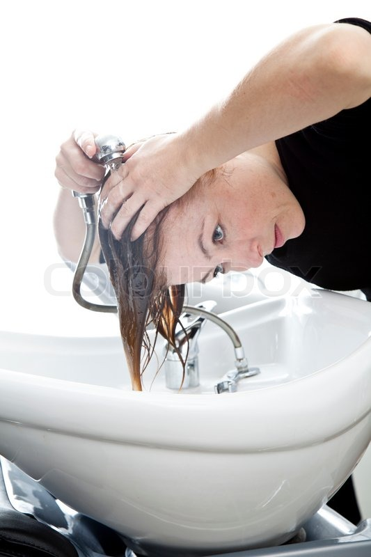 Elegant A Woman Washing Her Hair On A Sink In A Hair Salon | Stock Photo | Colourbox