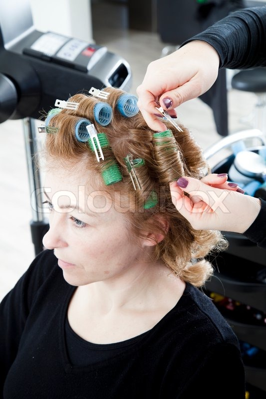A Woman Getting Hair Perm Stock Photo Colourbox