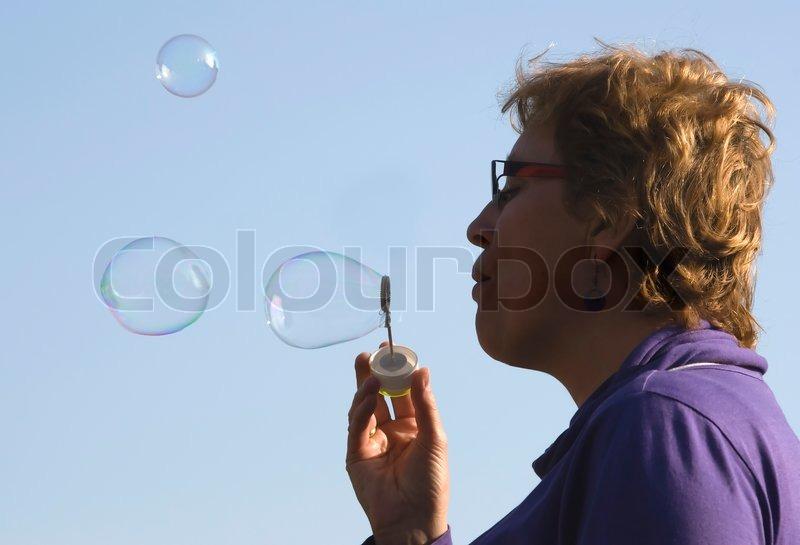Blowing woman, stock photo