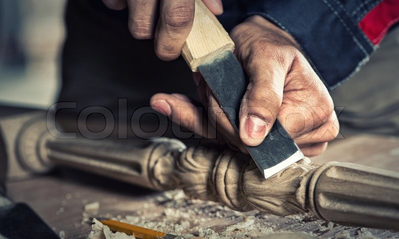 Close up carpenter\'s hands that work with cutter, stock photo