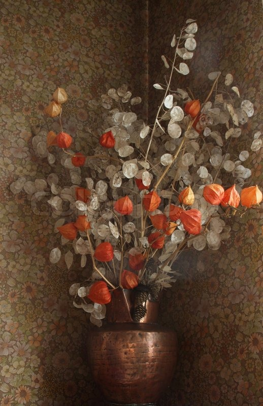 Red And White Dried Flowers In A Vase Of Copper Stock