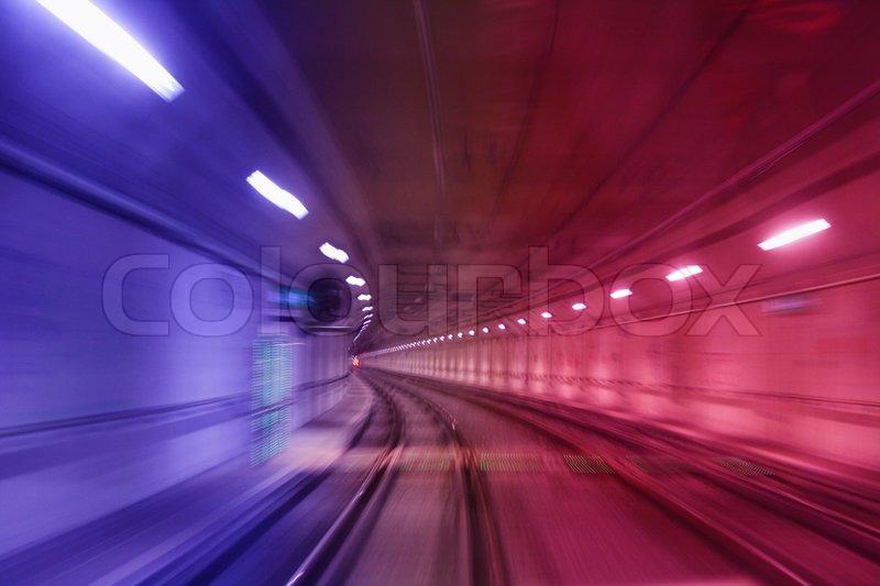 Blurred view of underground railroad track, stock photo