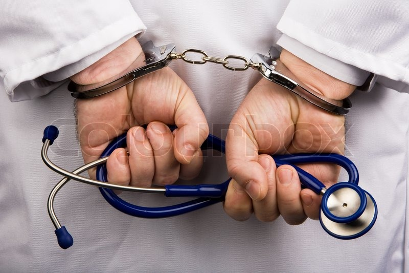 Physician notes and handcuffs. Crime in Medicine, stock photo