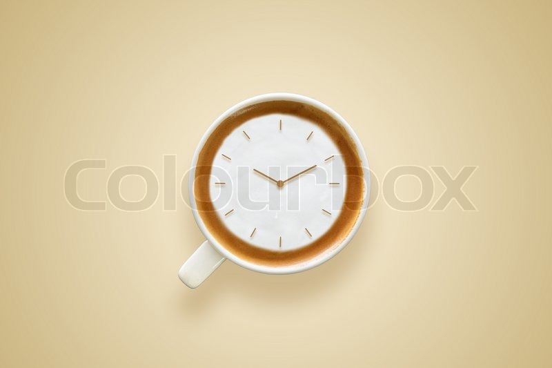 Coffee time , watch drawing on latte art coffee cup , stock photo