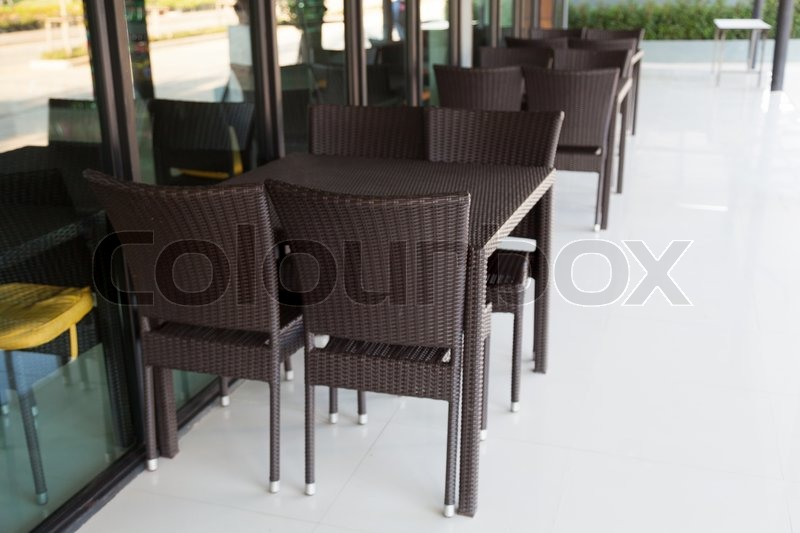 Chairs and tables in a restaurant Black chairs and tables in the restaurant for customers, stock photo