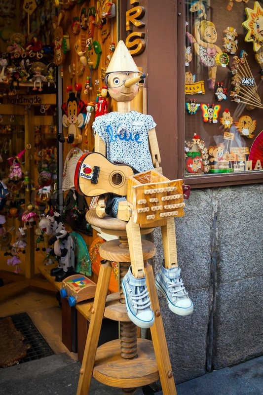 Madrid, Spain - May 6, 2012: Vintage wood toy shop with Pinocchio dool exposed on front in Madrid, Spain, stock photo