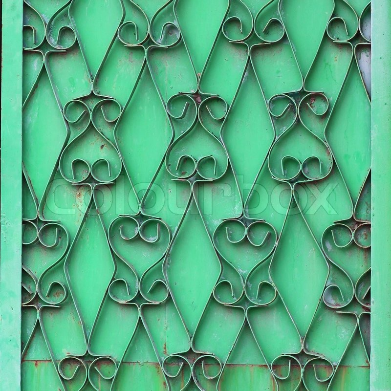 Ornamental wrought iron green wall grunge fabric abstract texture wallpaper, stock photo