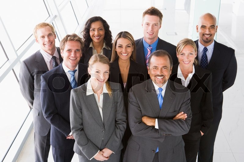 Overhead view of office staff looking to camera, stock photo