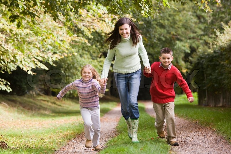 Mother And Children Running Along Stock Photo Colourbox