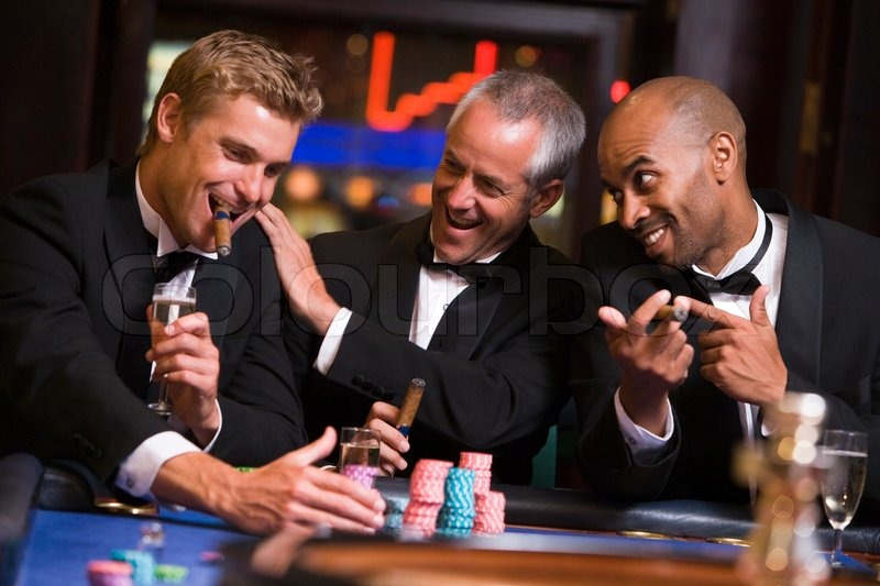 Three men gambling at roulette table in ... | Stock image | Colourbox