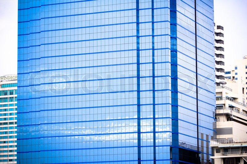 Windows of office buildings, cool business background in Bangkok, stock photo