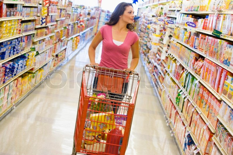 Young woman grocery shopping in supermarket | Stock Photo ...