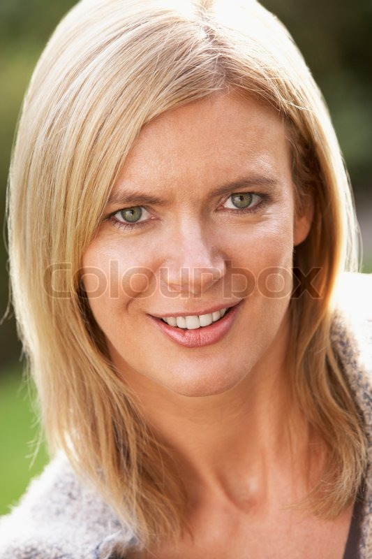 Close Up Portrait Of Smiling Blonde Woman Outdoors  Stock -3341