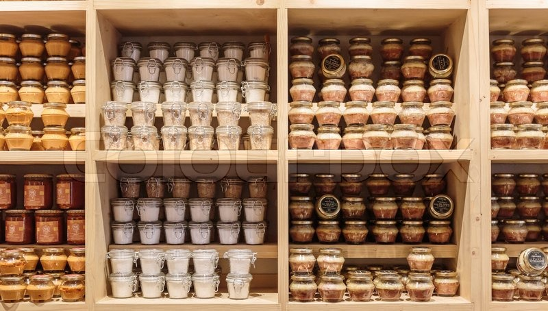 NICE, FRANCE - OCTOBER 30, 2014: Canned products on the shelf in the store, stock photo