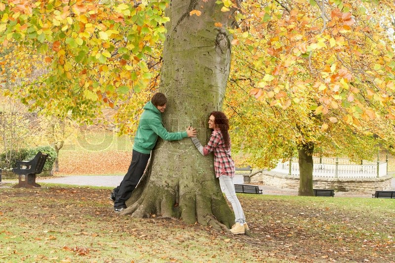 Romantic Teenage Couple By Tree In  | Stock image