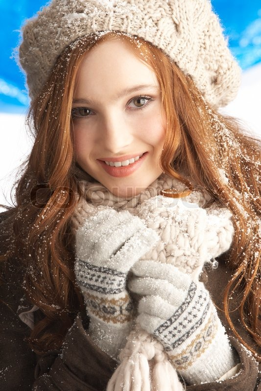Teenage Girl Wearing Warm Winter Clothes And Hat In Studio ...