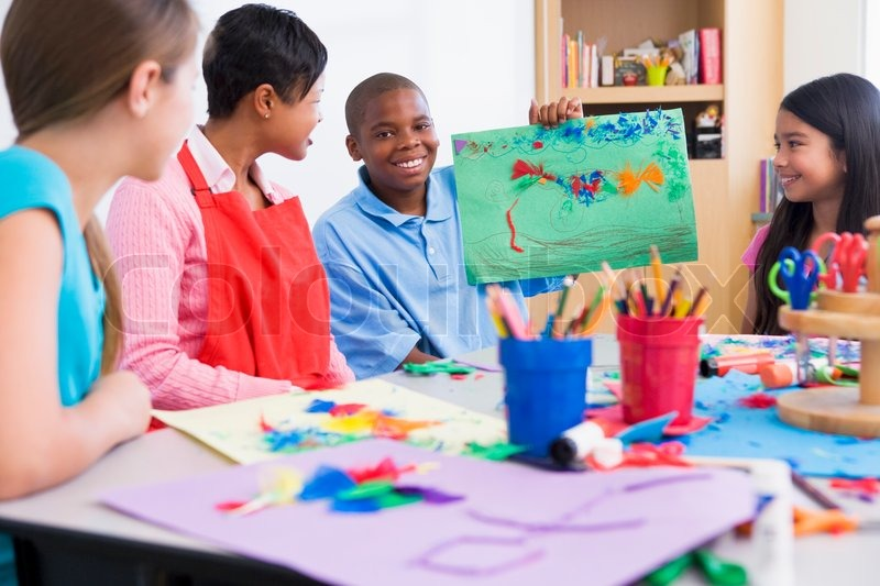 Elementary school art class with pupil discussing picture for Craft classes for toddlers