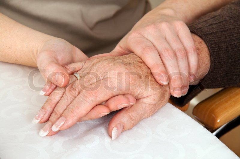 A young woman comforting a widow after death. Bereavement support, stock photo