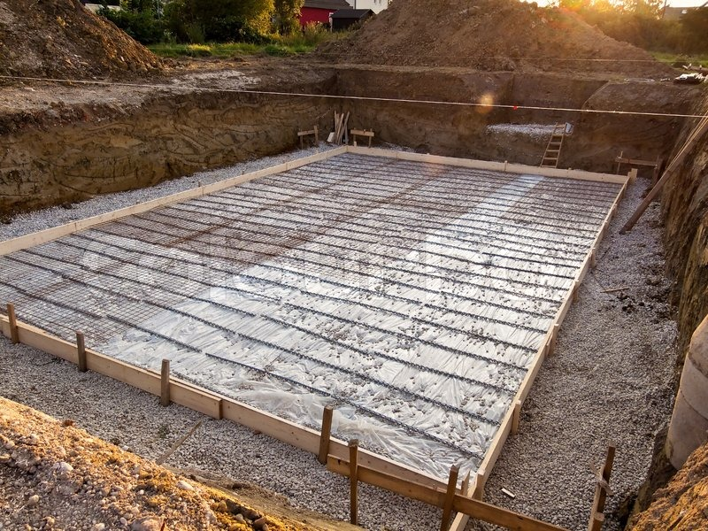 Foundation slab of a basement in house construction for Slab built homes