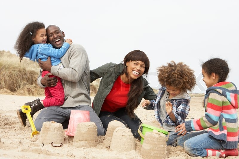 Young Family Building Sandcastle On Beach Holiday  Stock -7770
