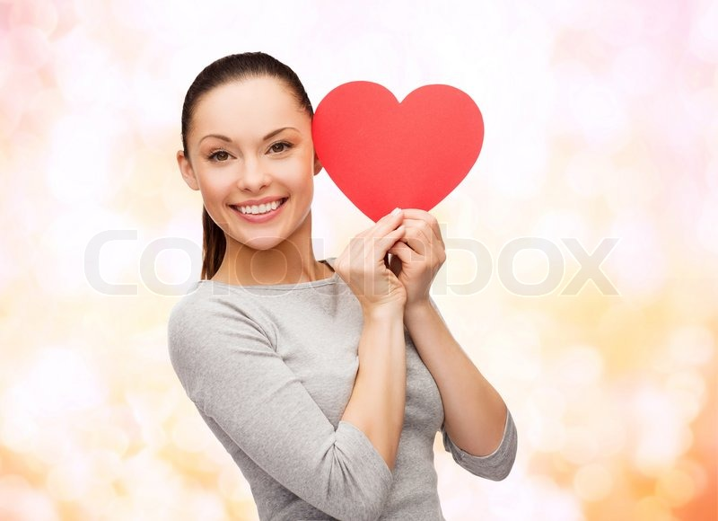 Happiness, love and health concept - smiling asian woman with red heart, stock photo