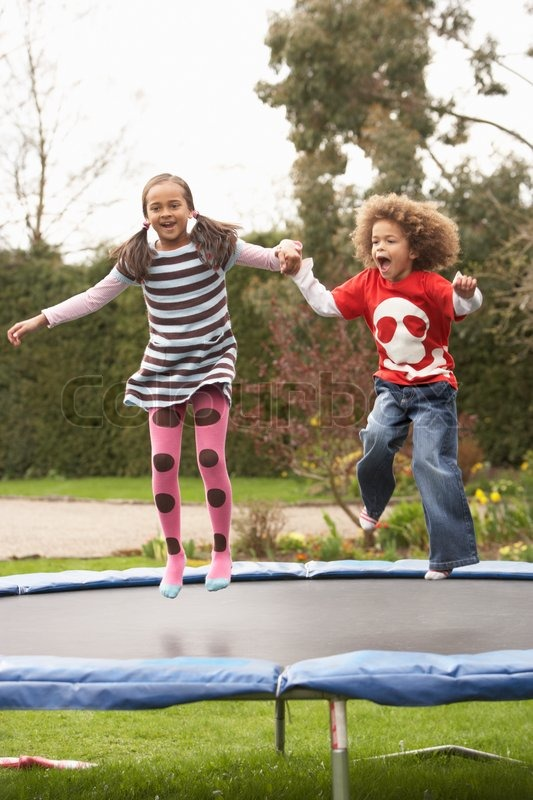 spielende kinder auf trampolin stockfoto colourbox. Black Bedroom Furniture Sets. Home Design Ideas