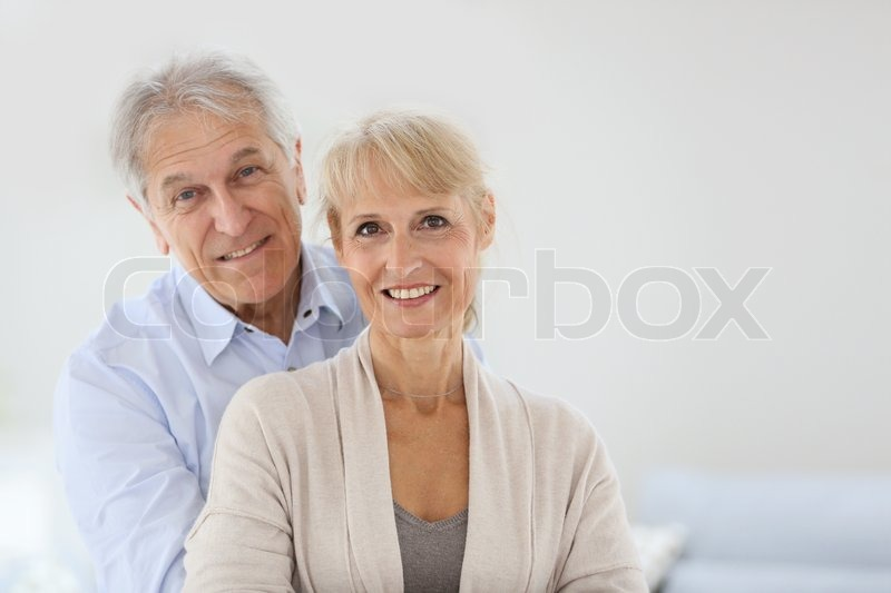Cheerful senior couple embracing each other, stock photo