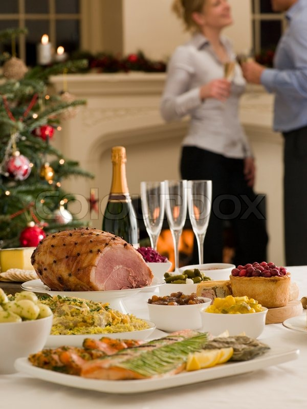 Stock image of 'A couple celebrating the holiday with Christmas dinner'