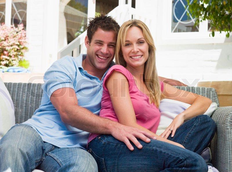 mann und frau sitzen drau en im garten stockfoto colourbox. Black Bedroom Furniture Sets. Home Design Ideas