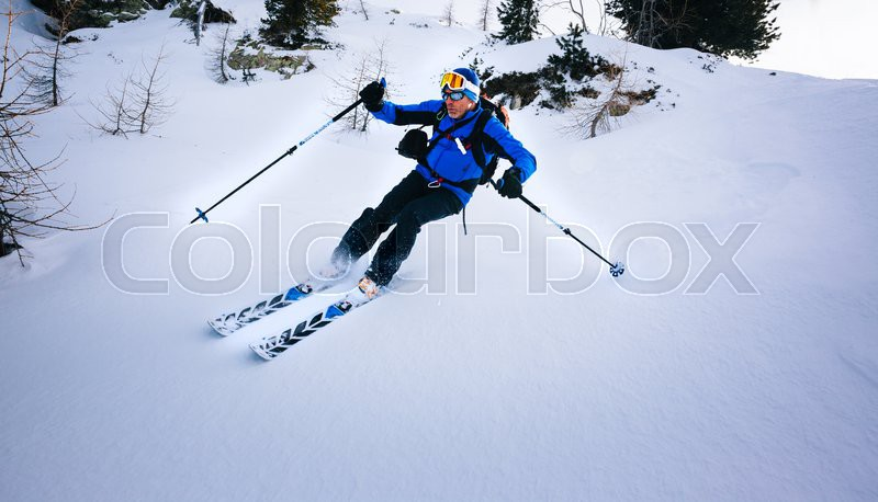 Winter sport: man skiing in powder snow. Val D\'Aosta, italian Alps, Europe, stock photo