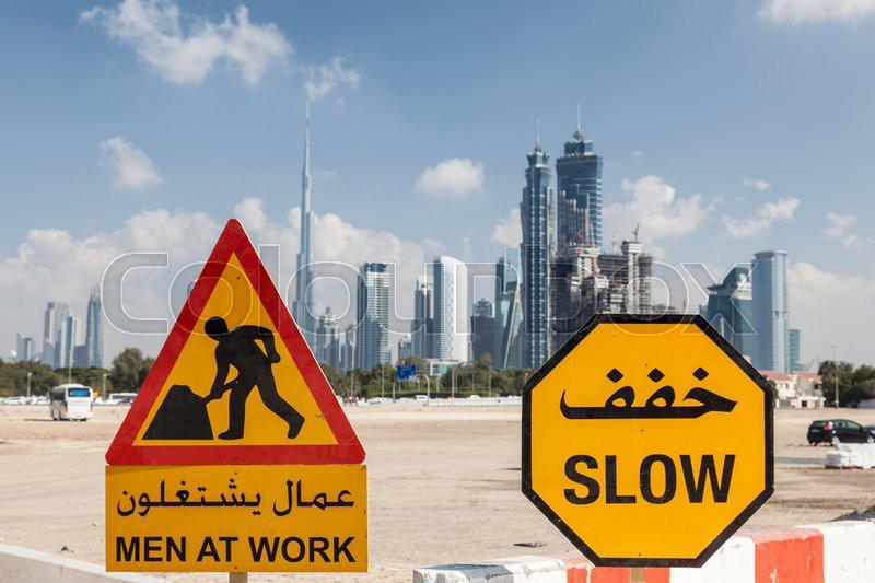 Men At Work sign in the city of Dubai, United Arab Emirates, stock photo