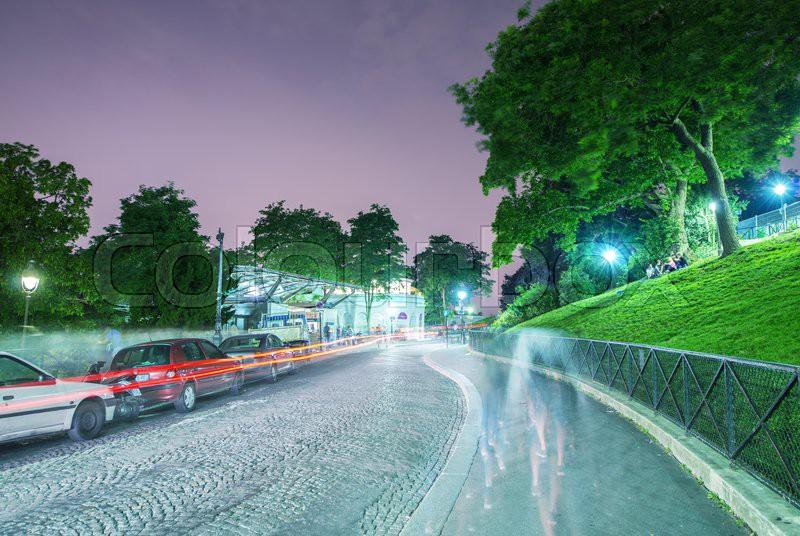 Beautiful streets of Montmartre at night, Paris, stock photo