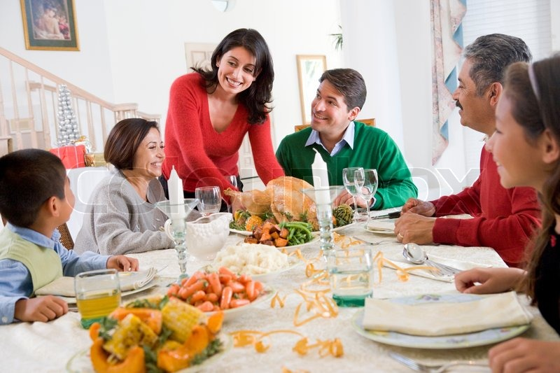 A Latin American Family Enjoying Christmas Dinner Stock Photo