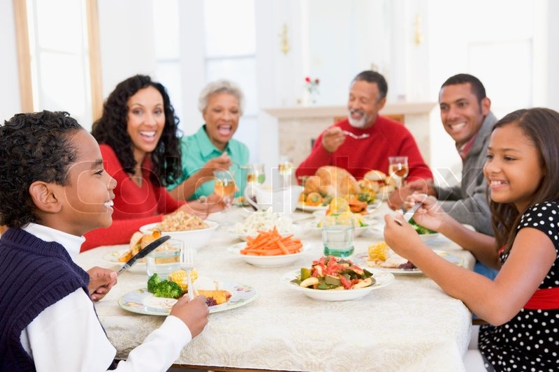 An African American Family Enjoying Their Thanksgiving Dinner