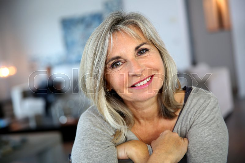Portrait of attractive and serene mature woman, stock photo