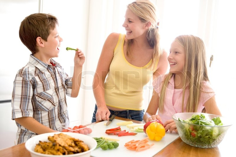 Stock image of 'family, vegetables, cooking'