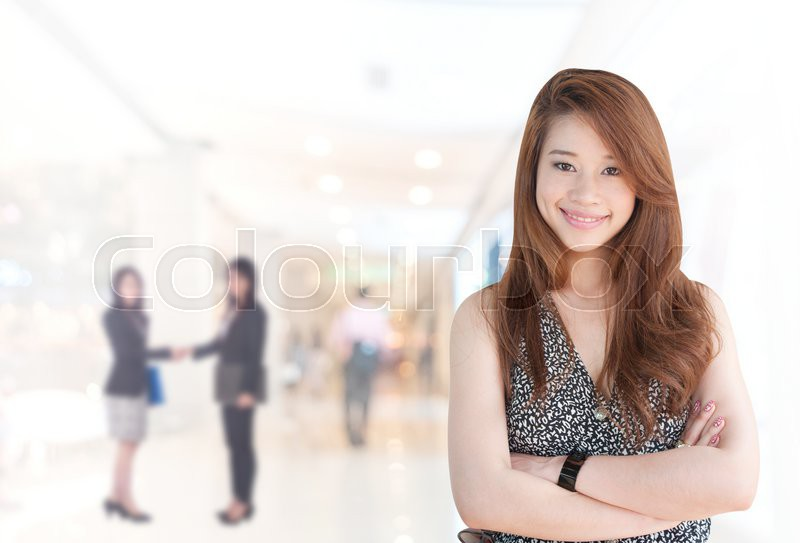 Portrait of young asia business woman 20 - 30 year old in her office.Mixed Asian / Caucasian businesswoman.Positive emotion, stock photo